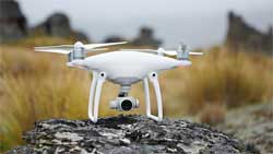 The Phantom 4 is DJI's newest camera drone, and weighs less than 2kg.