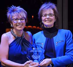 Gaby Mullinax accepts the PMDA Visionary Ward at CES 2015 2015 from then general manager Joellyn Gray.