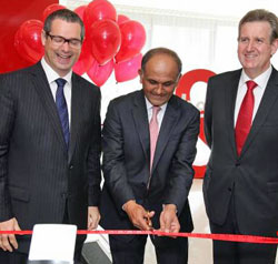Sharing the love: Senator Stephen Conroy, Adobe CEO Shantanu Narayen and NSW Premier Barrie O'Farrell at the Adobe office opening.