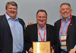 PMA president Allen Showalter, Jeff Crowley  with his Distinguished Service Award, and PMA Australia chairperson, Phil Gresham.
