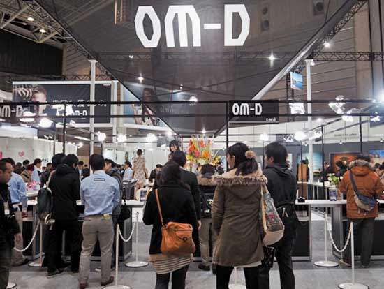 The Olympus stand was a veritable altar to the OM-D system, with visitors keen to get hand-on with the new EM-10.