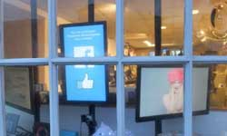 The shopfront window consists of small panes which lend themselves to displaying smaller screens.