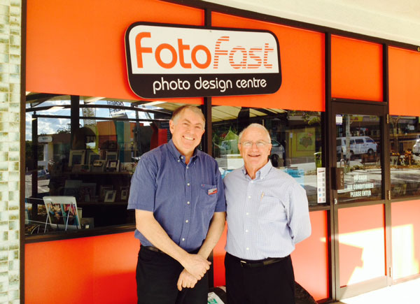 Phil Gresham and PMA director Peter Rose bask in the sunshine outside the new Fotofast Photo Design Centre in Taringa.