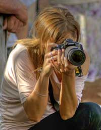 kneeling-woman-with-camera
