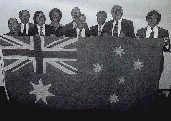 They say a cobblers shoes always need mending, so we suppose this badly-lighted, grainy effort seems the best the photo industry leaders could do in 1979! The occasion was the transformation of the Photographic Dealers Association to PMA Australia. Holding the flag, from left to right are: Alistair Moss, Les Brener, a moustached long haired git who I suppose is me, John Paxton, Ken Peters, Joe Mitchell, someone whose name will come to me at 2.00am tonight, Jack Wagner and Keith Williams. PC