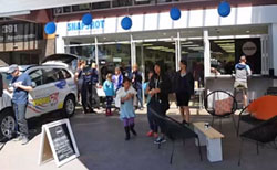 The local radio station supported the Snapshot grand opening. The coffee shop servery is on the right.