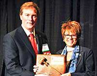 Penultimate PMA president Bill Eklund hands over to Gabby Mullinax in January, 2015.