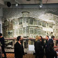 This mural of the Michaels Corner building is composed of 600 images of past and present Michaels staff.